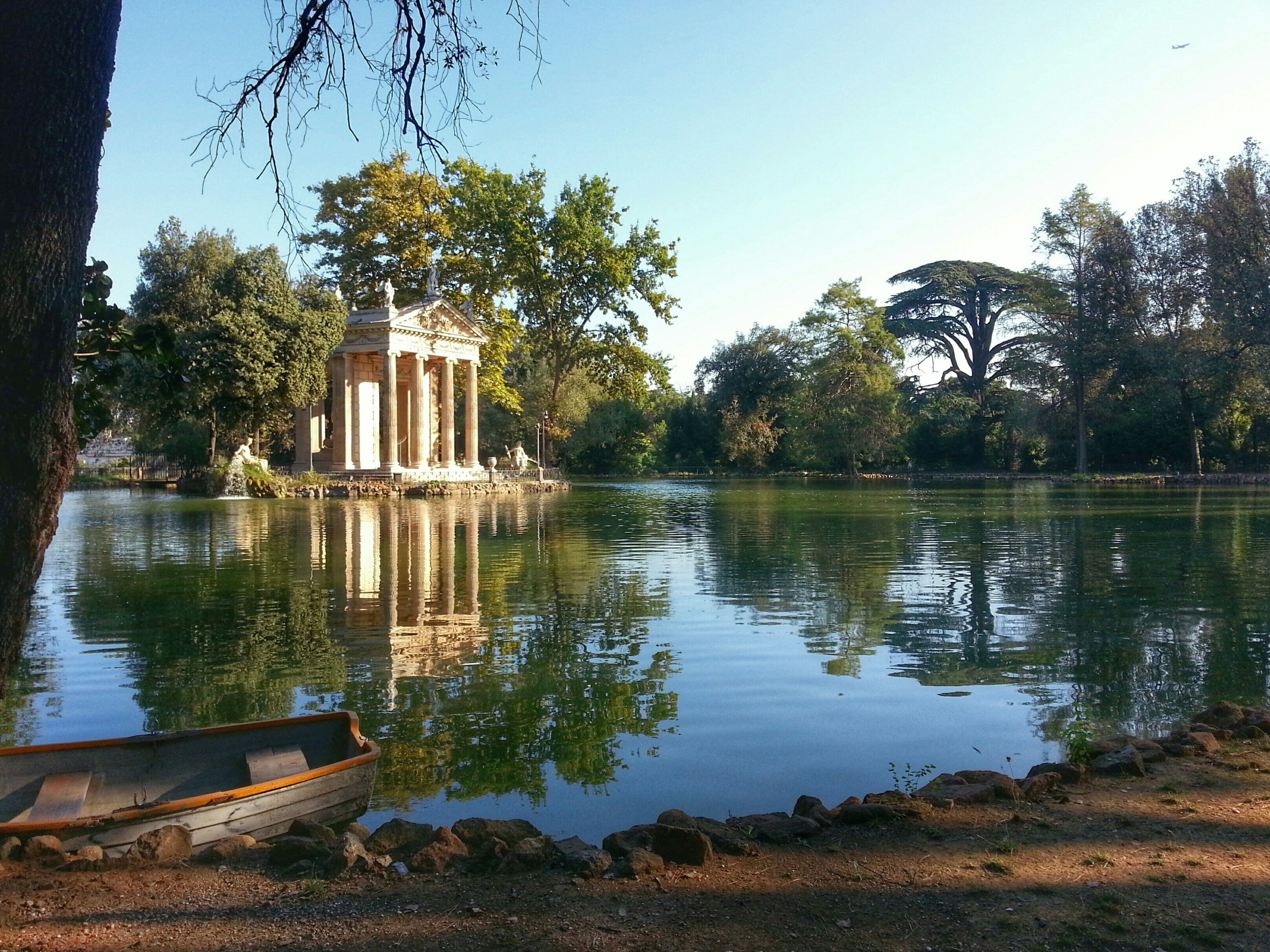 Abandoned Boat In Pond With Reflection At Villa Borghese Gardens