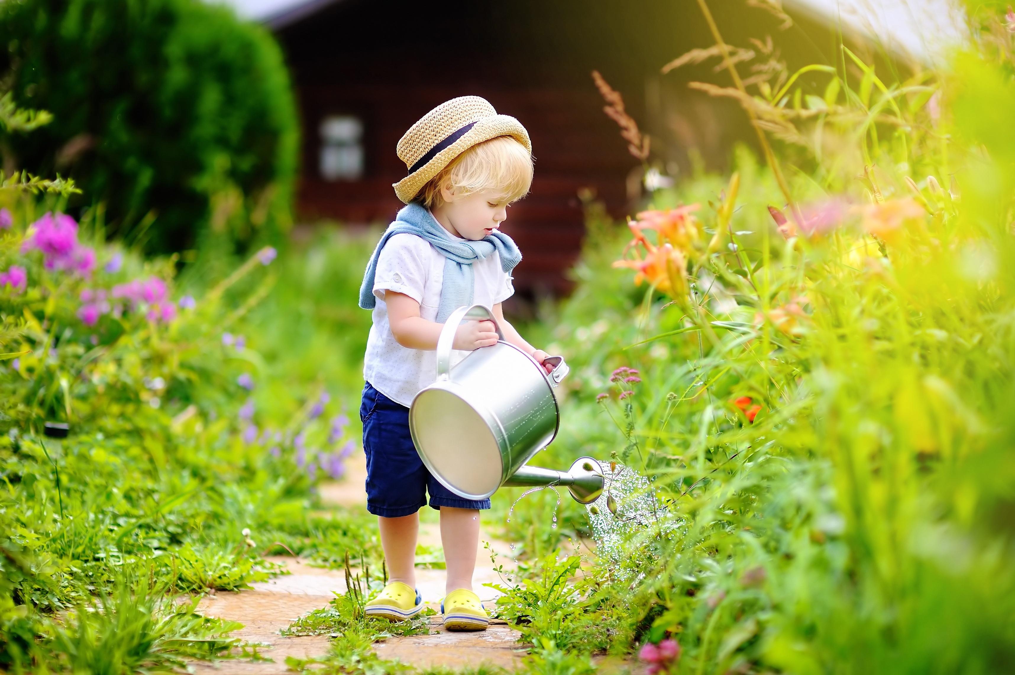 Cute toddler boy in straw hat watering plants in the garden at summer sunny day; Shutterstock ID 462068086; Title: britse babynamen