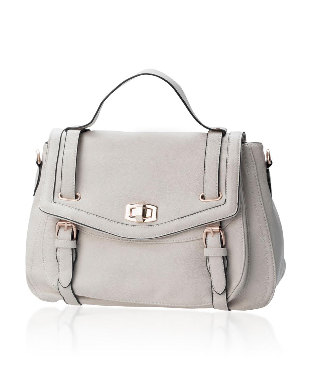 Wat is toch dat witte zakje dat in een nieuwe tas zit?
