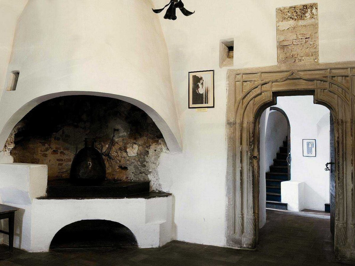 inside-the-castle-is-filled-with-huge-customized-stoves-to-keep-its-residents-warm-and-doors-that-still-retain-their-original-stone-work
