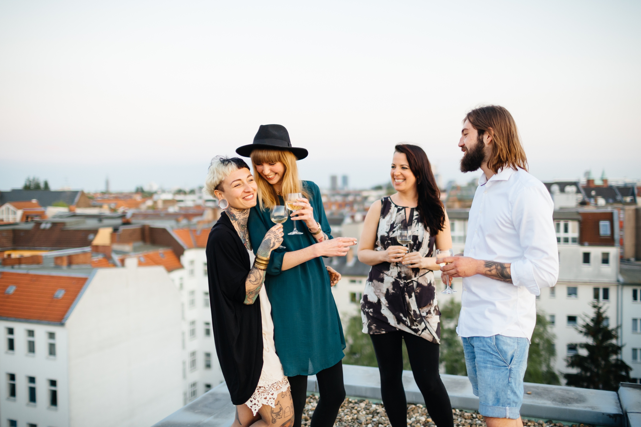 Friends standing on rooftop and having fun