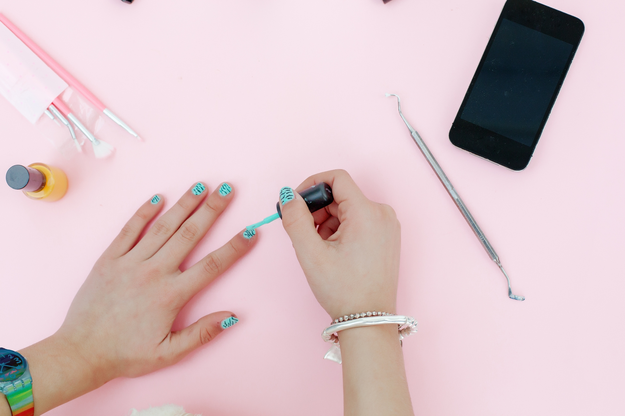 Close-up of teenage girl painting nails