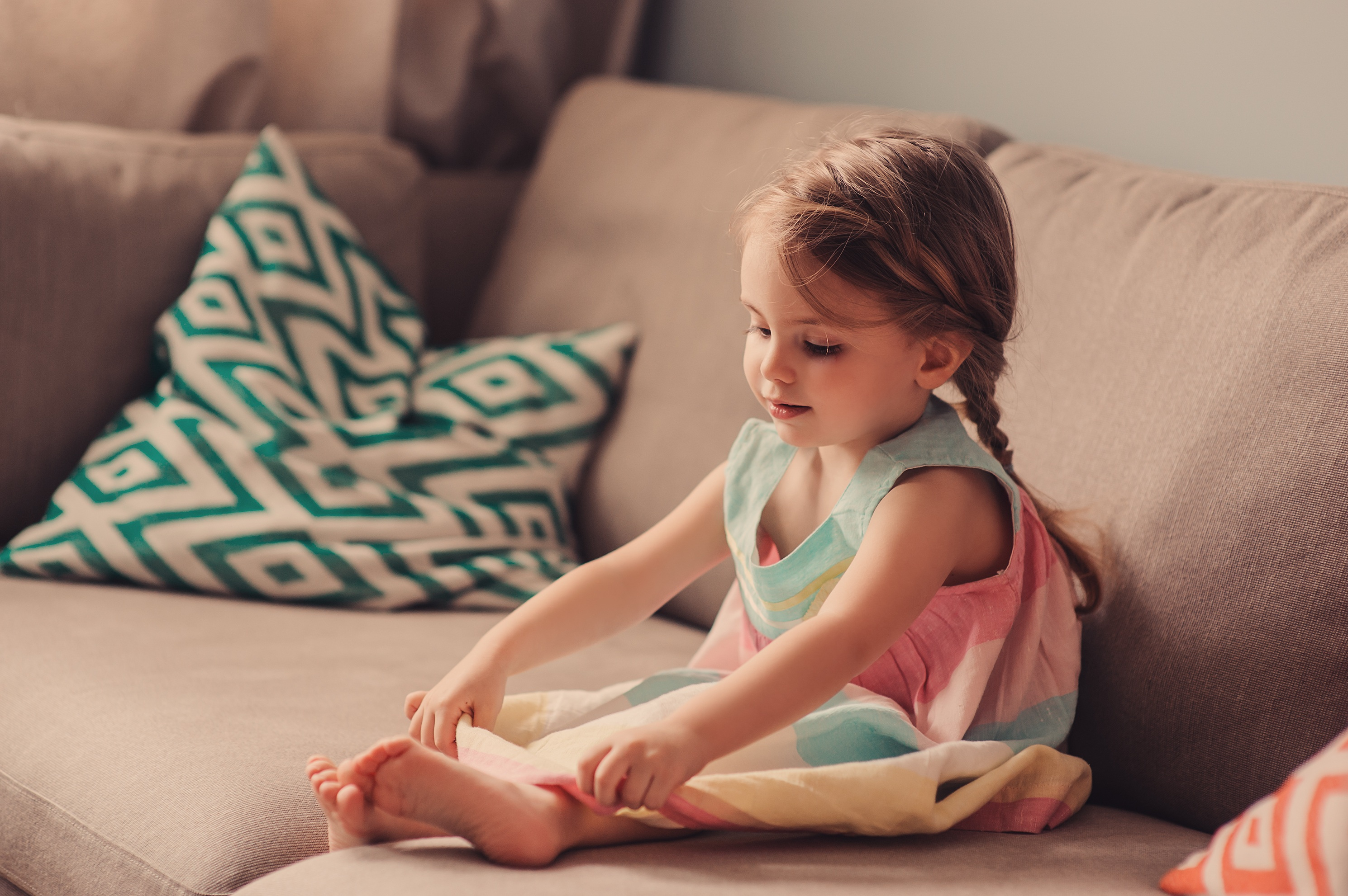 cute toddler girl playing on sofa at home; Shutterstock ID 331899005; Title: britse babynamen
