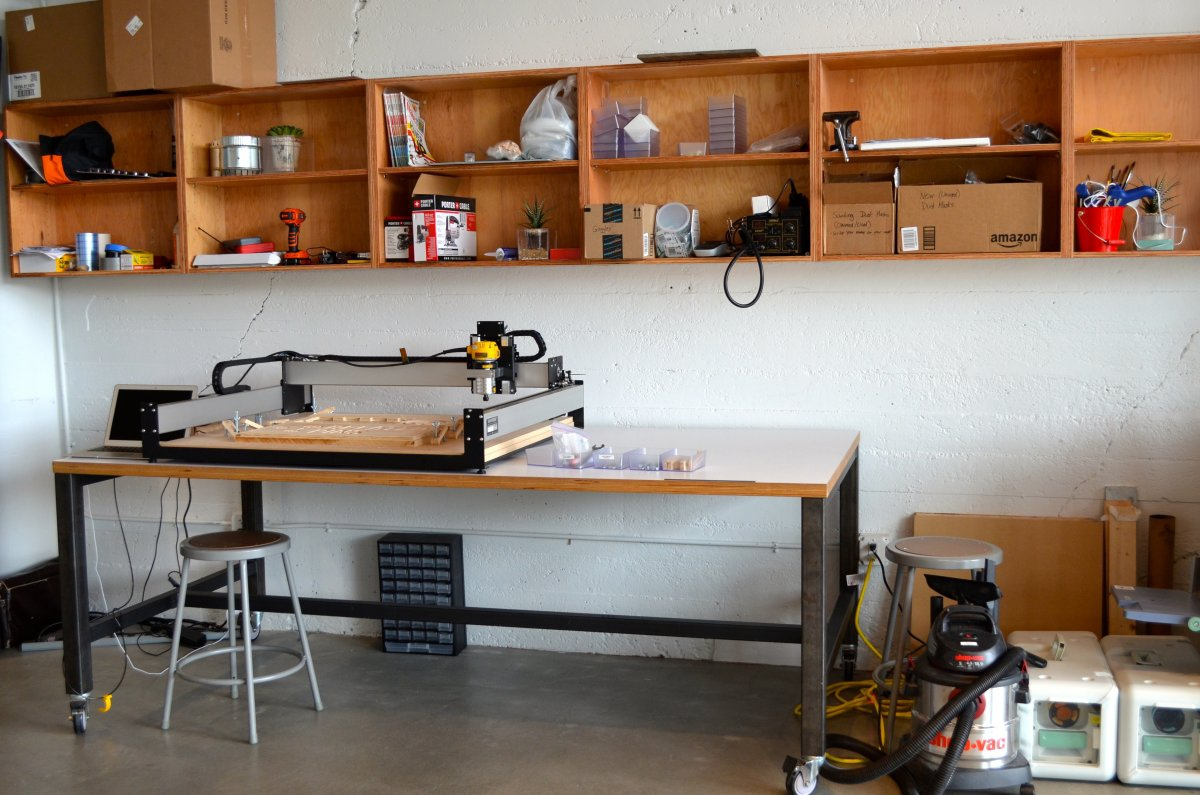 its-decked-out-with-a-bunch-of-manufacturing-materials-and-tools-when-we-visited-one-employee-showed-off-a-light-he-was-making