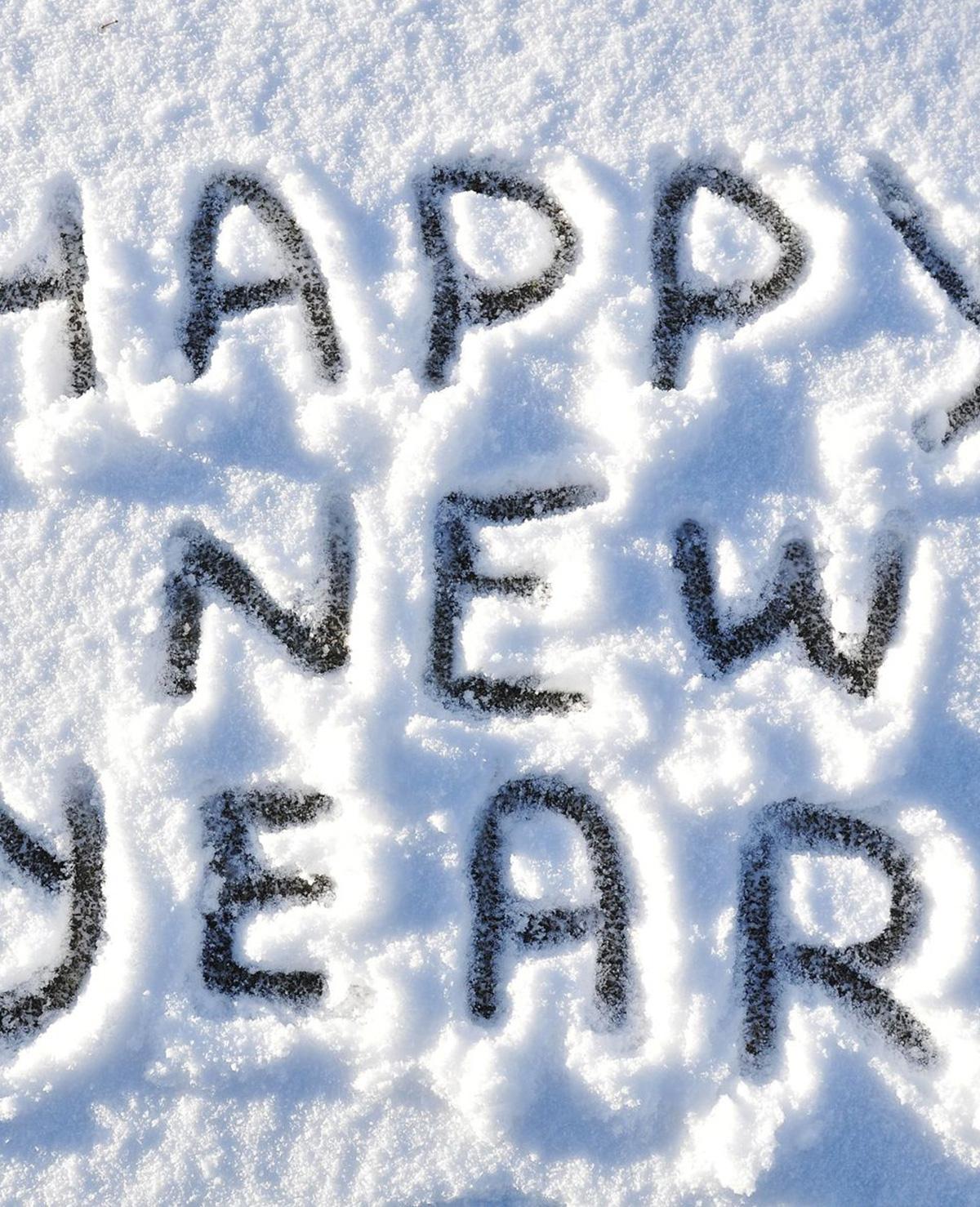 Collega's gelukkig nieuwjaar wensen met een zoen, doen?