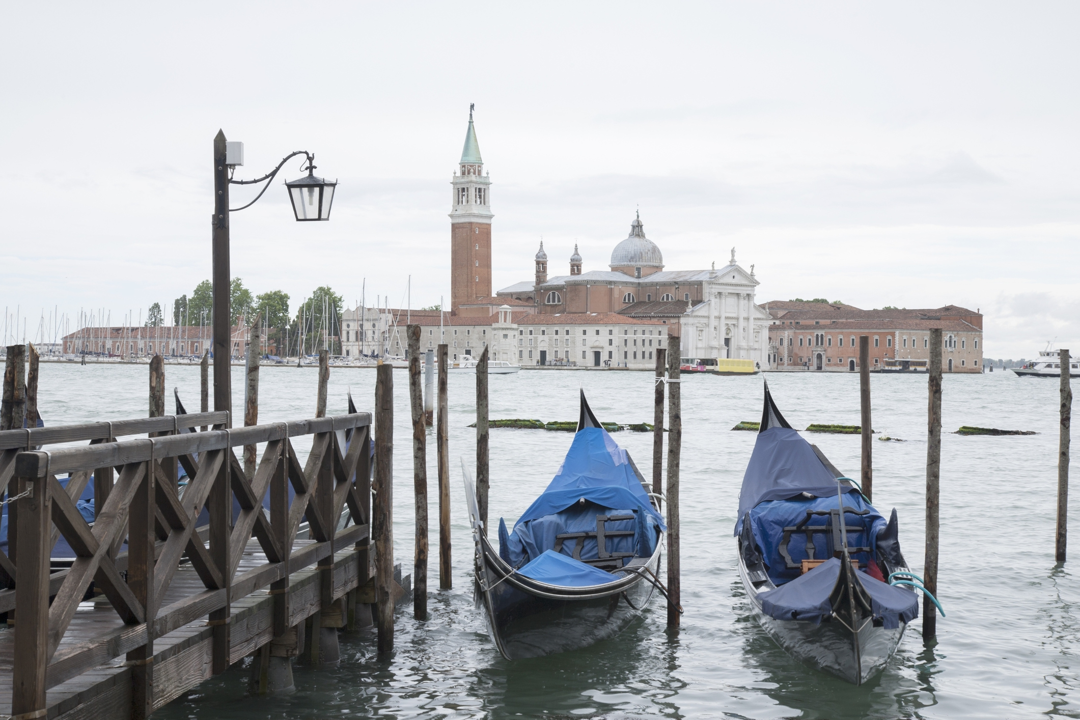 Italy, Venice, San Giorgio Maggiore Church and bell tower with gondolas in foreground