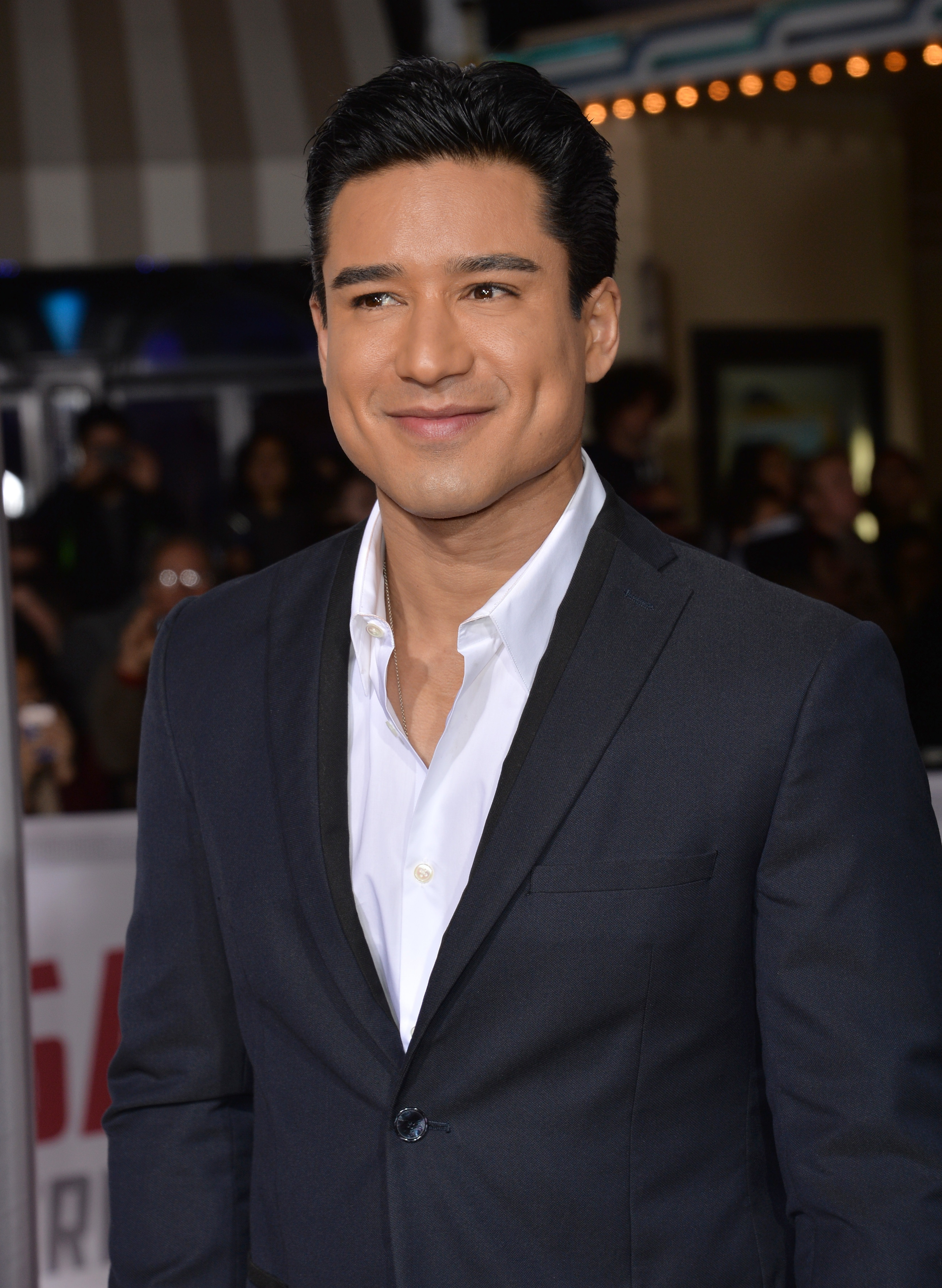 """LOS ANGELES, CA - FEBRUARY 1, 2016: Mario Lopez at the world premiere of """"Hail Caesar!"""" at the Regency Village Theatre, Westwood.; Shutterstock ID 435198598; Title: saved by the bell cast"""